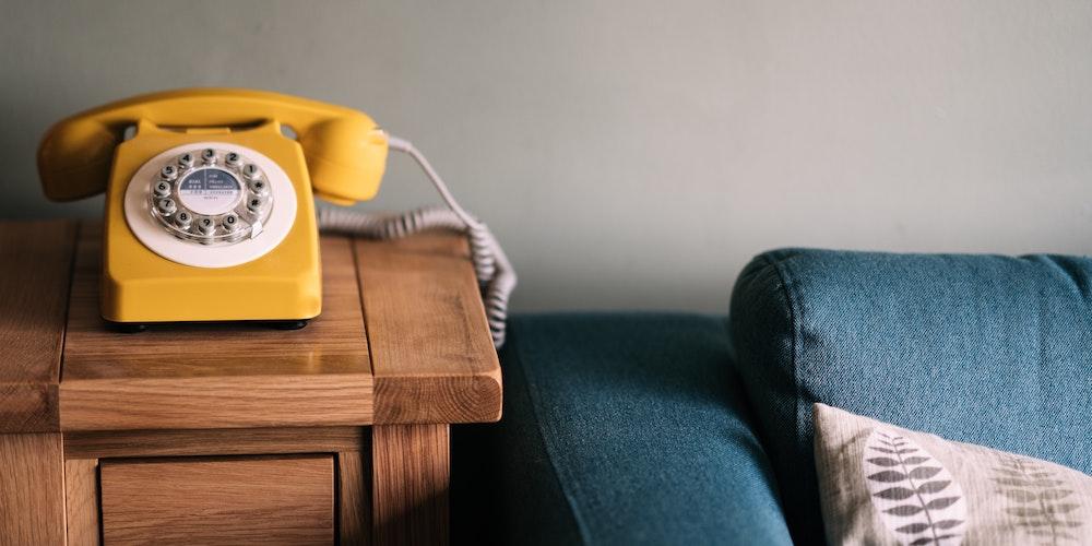 Telephone next to sofa